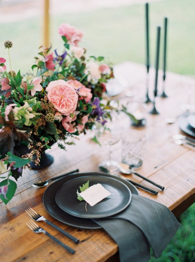 Black plates + flatware paired with colorful blooms: http://www.stylemepretty.com/florida-weddings/redlands/2016/05/24/this-enchanted-fairytale-inspiration-has-it-all-including-prince-charming/ | Photography: Katie Lopez - http://katielopezphotography.com/