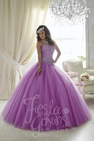 This lace and tulle gem will fit your event perfectly as it shows off its multi-colored ruffles and ornately decorated bodice with lace-up back. Download the Quinceanera Collection by House of Wu sizi