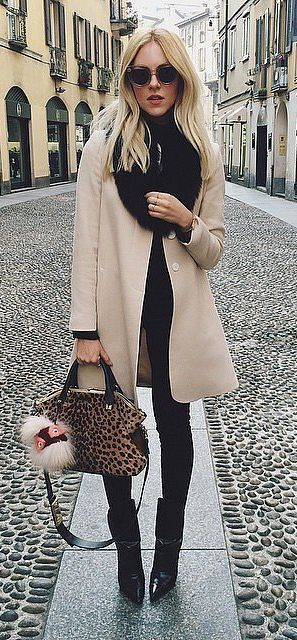 Camel Coat Layered Over Leggings and a Black Top