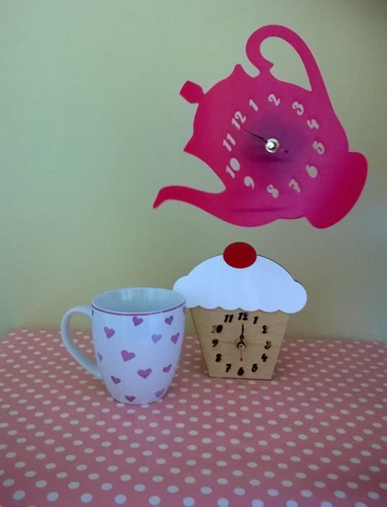 Fun and very eye catching clock display!   Handmade laser cut acrylic and wood clocks. All of which are designed and created with us in Pembrokeshire, South West Wales!