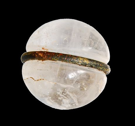 A hand-cut rock crystal ball encircled by a metal ring dates back to the Bronze Age and served as a ritual object in Afghanistan