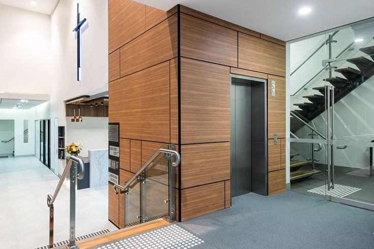Navurban™ Byron Blackbutt | This recently completed fit-out at the Ann Street Presbyterian Church in Brisbane was completed by Xenia Constructions. It features wood panelling on the walls around the lift cores to give the foyer a more contemporary feel.