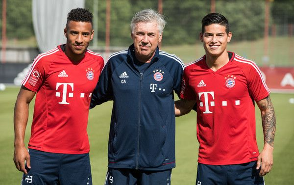 Head coach Carlo Ancelotti poses with Corentin Tolisso (L) and James Rodriguez before a training session at Saebener Strasse training ground on July 12, 2017 in Munich, Germany.