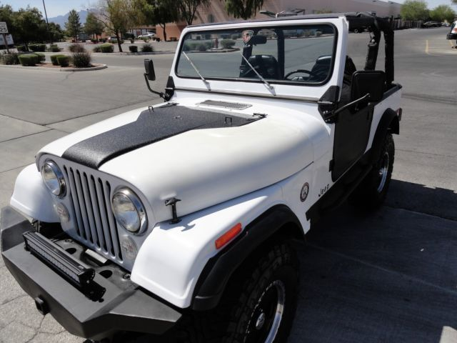 JEEP CJ7 - RESTORED - V8 POWER - 4 SPEED - ROLL CAGE - PS - PB SEE VIDEO for sale: photos, technical specifications, description