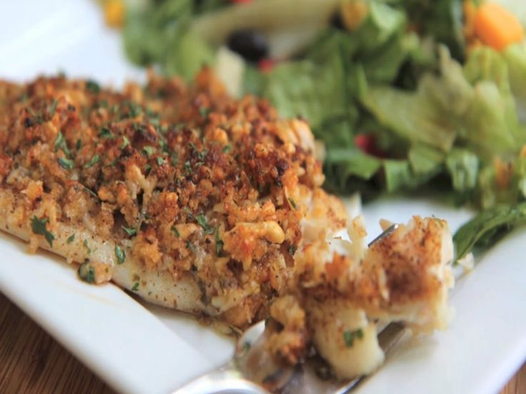 Seasoned tilapia topped with a golden parmesan breadcrumb crust. Easy quick and tried and true This baked parmesan tilapia recipe is company worthy but...