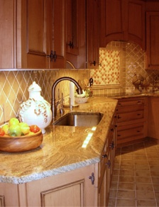 Warm undercabinet lighting highlights a beautiful backsplash!