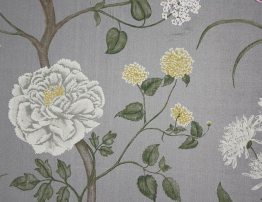 Summer Tree Silk Fabric A silver silk fabric with a printed climbing leaf design with ivory flowers, some with hints of bright mustard yellow and violet.