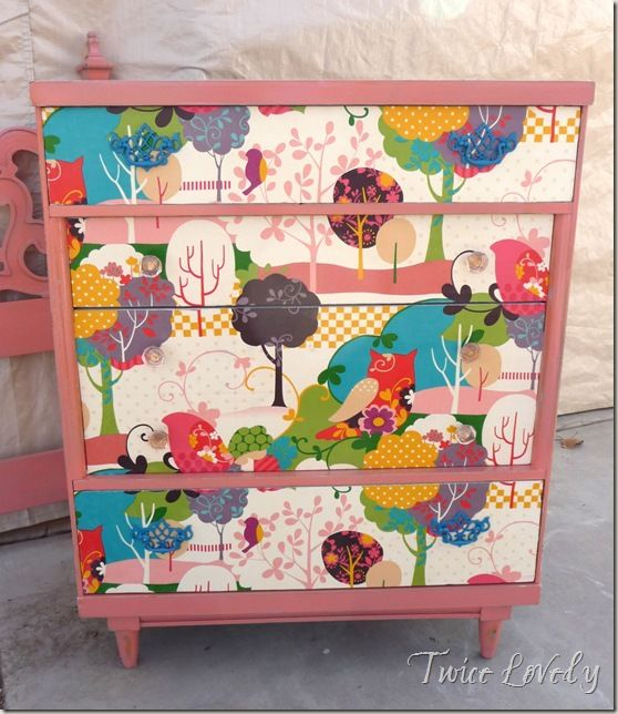 fabric-podged chest of drawers - I painted a hearty coat of Mod Podge on the front drawer faces, then applied the fabric to the fronts, let that dry, then added 3 coats of polycrylic (my fave is Verathane) to protect the fabric and make the drawer faces cleanable