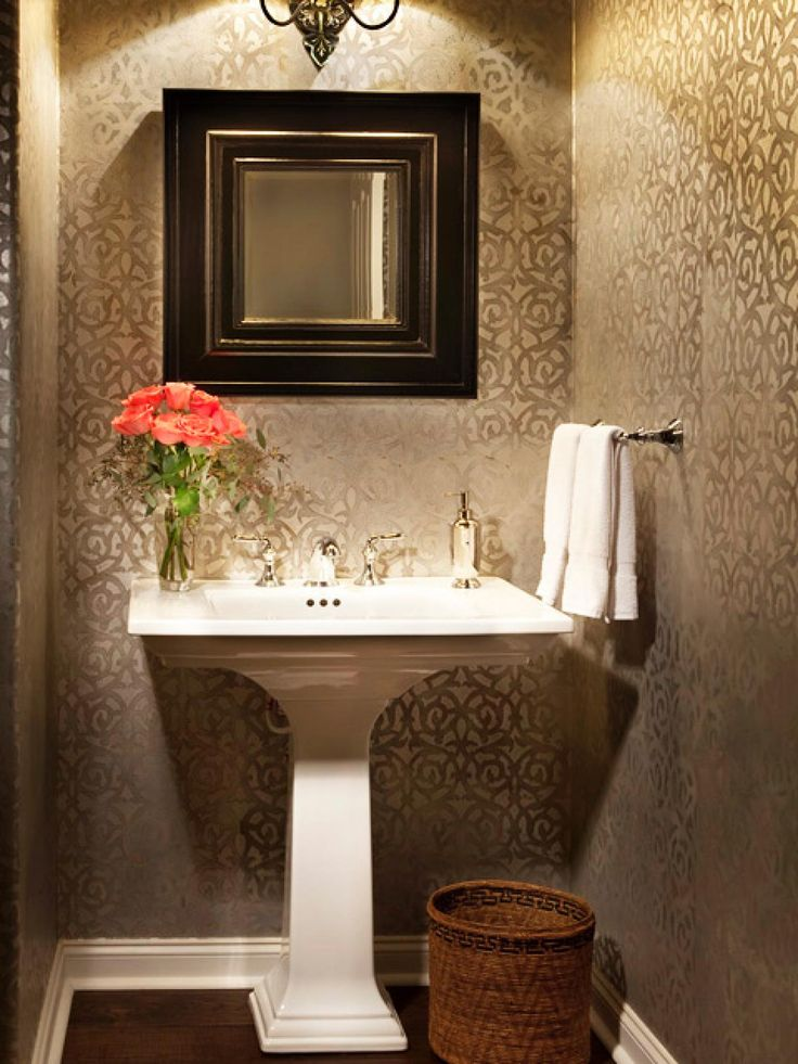 Art Exhibition A mix of stone marble and tiles create a rich and elegant master bathroom