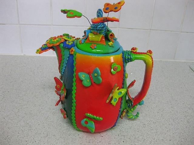 Tea in your garden with pretty flutterbys. www.missdinkles.com