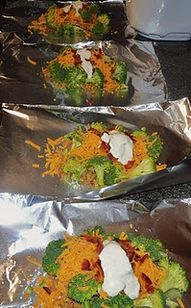Chicken & Broccoli packet--- I made a variation of this and it was SOOOOO good. Chicken, ranch dressing powder mixed with sour cream spread on top brocc and carrots surronding it and some shredded cheese on top. In oven at 350 45 min- SOOOOO YUMMY!