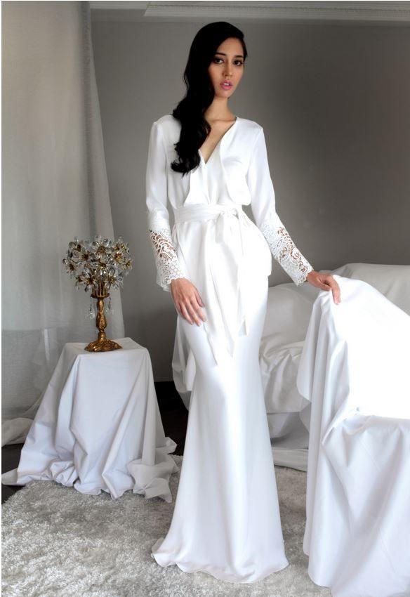 Alia Bastamam wrap top with lace cuff, mermaid cut skirt. Crepe silk material.