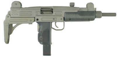 Uzi submachine gun with metallic buttstock in folded position