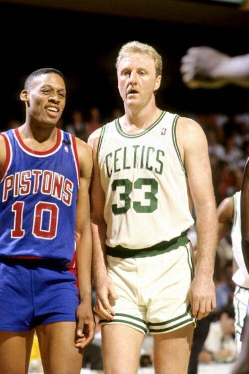 Dennis Rodman (Detroit Pistons) and Larry Bird. Kinda weird seeing a (normal) Dennis Rodman.