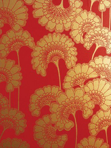 Breaking with traditional conventions of her time, (Australian décor tended to be flat in colour and conservative) she used bold images, textural effects to add depth, experimented with layering patterns and colour, metallic inks and surfaces and played with scale and size.  Japanese Floral in Chilli Red on Tan Silk Slub wallpaper
