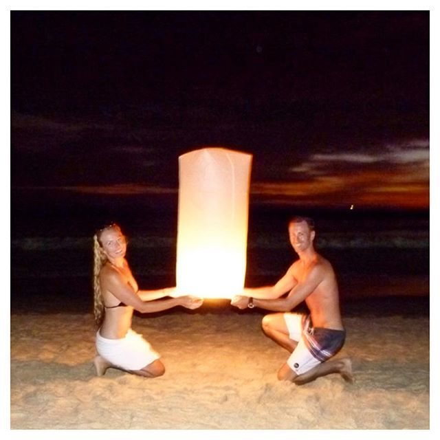 One of our most favourite and romantic moments! Setting off a lantern on our honeymoon! How will you be spending your Valentine's Day? :heart::sunrise: @honeymoonhangover #sunset #lantern #honeymoon