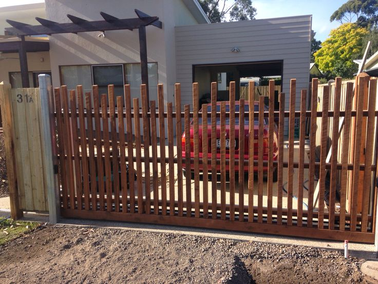 Cypress cladded automated electric sliding gate