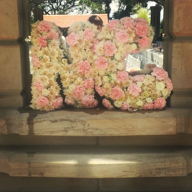 Love our custom floral initials! They're perfect as a photo prop for your wedding. Designed by Bliss Floral Creations