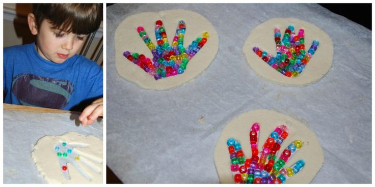 placing pony beads inside handprint to make handprint suncatchers