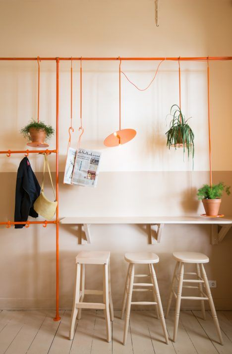 This construction is used to dangle many different items, including plants, lights and food products to fill the empty space below the cafe's lofty ceiling.