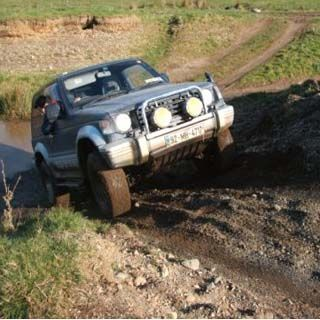4x4 Off-Road Driving Experience For Two - Holes, ditches, drops and slippery slopes, climbs and lots of mud! Tackle different surfaces and other exhilarating off-road conditions, all in truly stunning surroundings of Fennor 4 x 4 in Oldcastle, Co. Meath.