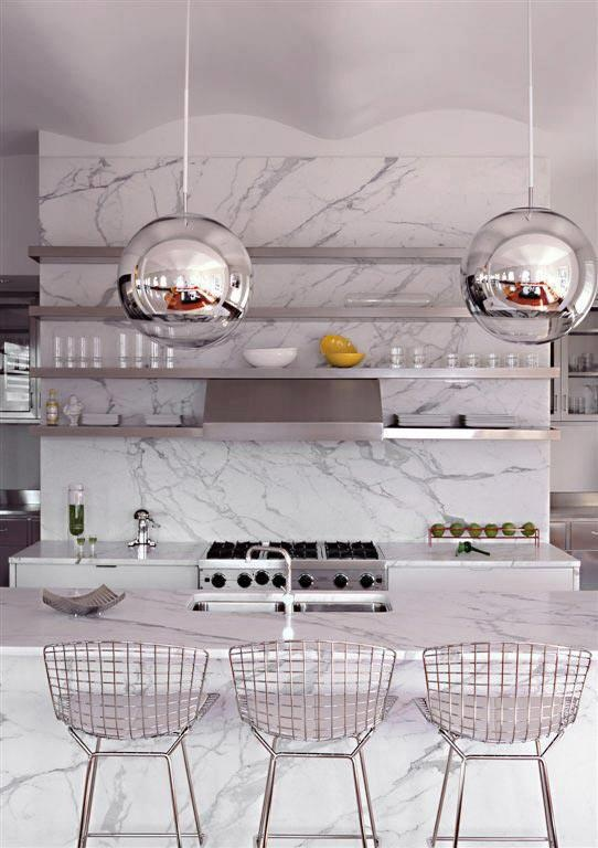Funky Pendant lights add flair to this clean marble kitchen