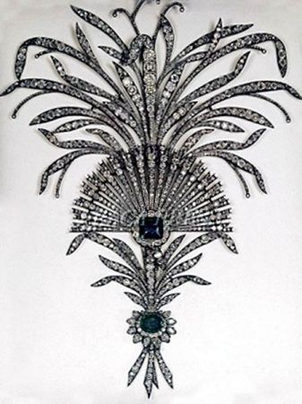 An elaborate diamond and emerald aigrette, set in silver. Part of the Iranian Crown Jewels.  This is what an aigrette is: https://en.wikipedia.org/wiki/Aigrette