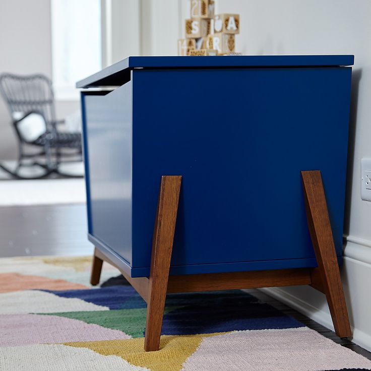 Shop Navy/Walnut Parkside Toy Box. Sure, this modern toy box is roomy and functional enough to hold all your kids toys in the playroom. But it's also stylish enough for you to be able to put anywhere in your home.