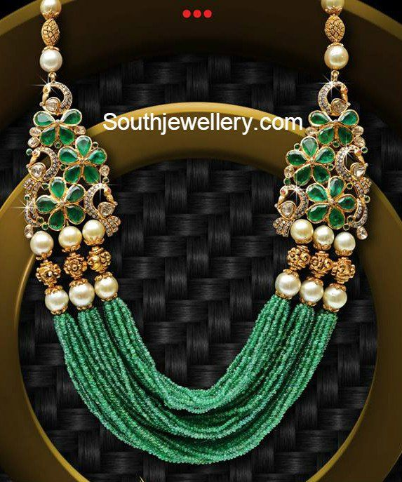 Multistring emerald beads mala with peacock motifs on either side adorned with emeralds, south sea pearls, nakshi balls and diamonds.