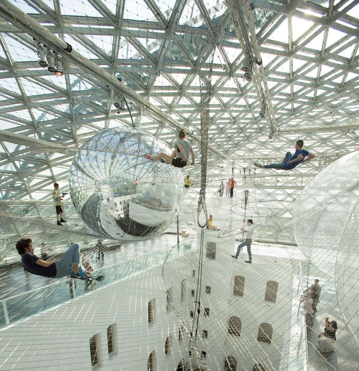tomás saraceno's large-scale installation 'in orbit' is suspended at a height of 20 meters, high above the piazza of the K21 ständhaus (kunstsammlung nordrhein-westfalen) in düsseldorf. opening, june 21st, 2013