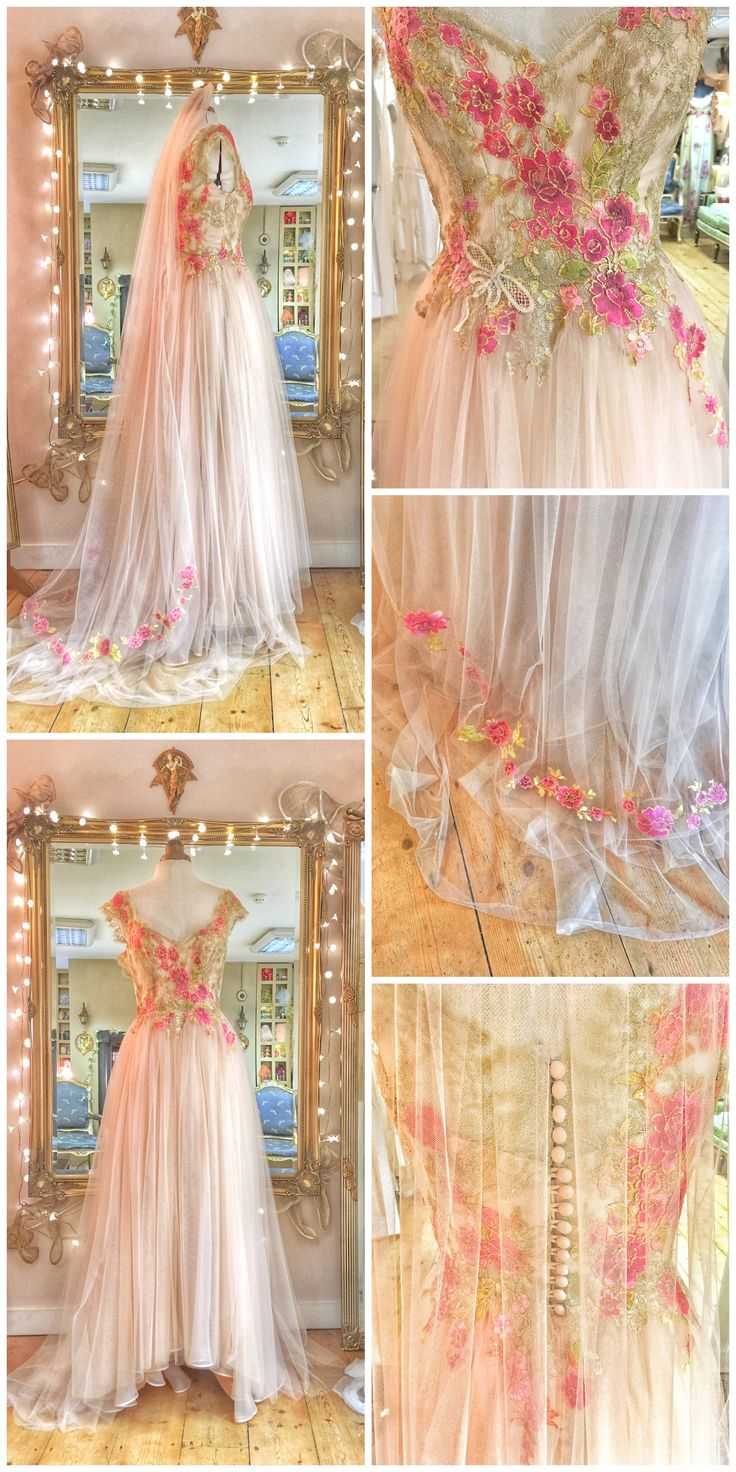Blush silk and tulle wedding gown with berry coloured flower embellishment and matching veil by Joanne Fleming Design