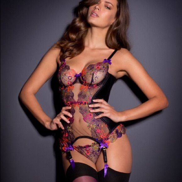 "Agent Provocateur ZURI Basque Corset Black New The Zuri boned basque made in sheer black tulle with beautiful French floral embroidery in purple, orange and pink It features underwired and unlined bra cups Sheer tulle back with hook & eye closure Four attached garter straps Satin purple bows complete the look on each garter strap, at the top of each cup and in the center Adjustable bra and garter straps with gold tone hardware engraved ""Agent Provocateur"" Agent Provocateur Intimates…"