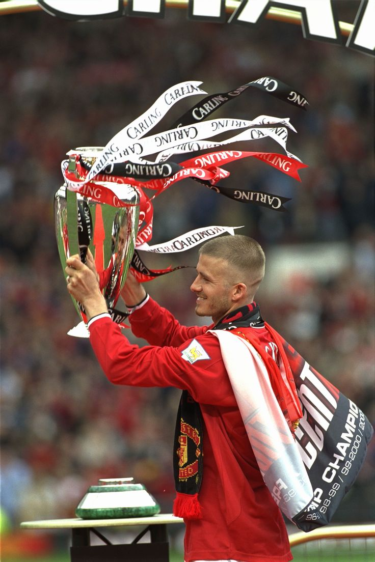 David Beckham celebrates winning the Premier League title with United in 2001.