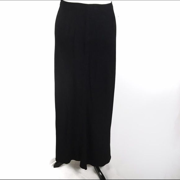 Benetton long wool skirt Good condition. Straight with a very slight trumpet bottom. Size 42 equates to a size medium (6ish) Benetton Skirts Maxi
