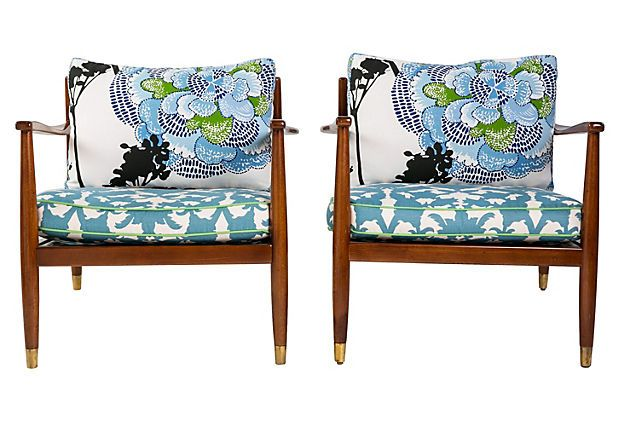 Crafted in Sweden (stamped on the underside of frame), these Mid-Century Modern armchairs disassemble for easy transport. The custom, Madcap Cottage-designed down/feather-and-foam cushions are covered in a mix of Thibaut and Marimekko fabrics. Seat and back cushions are removable. Metal supports under seat cushions. Feet have brass caps.