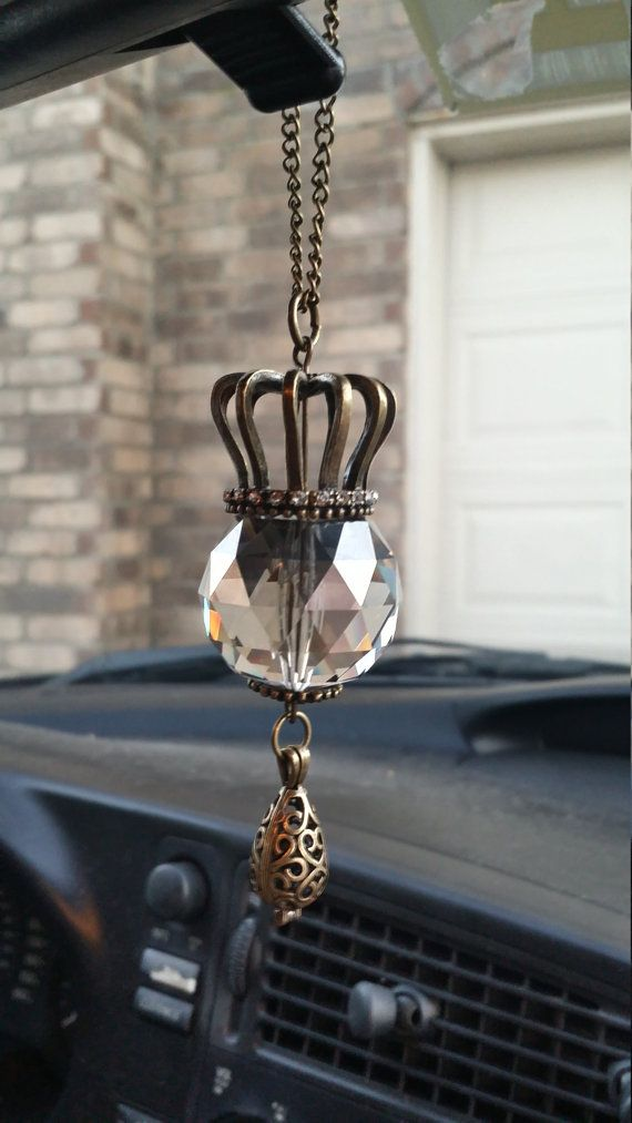 Essential Oil Diffuser Car Necklace, by Gypsy Dust!  This Diffuser Car Necklace is made to hang in the sun, from your cars rear view mirror!  With a dangling locket, filled with lava stones to add essential oils to, you can benefit from essential oils, even while driving in rush hour traffic!  Visit our Etsy shop to see more Diffuser Jewerly, or custom order your own piece!