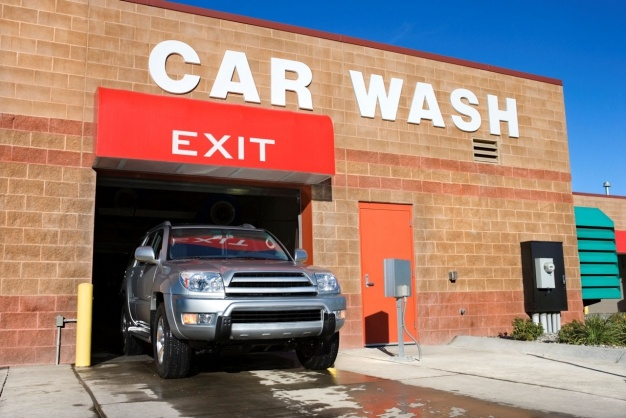 Pick a drive-through that is touchless or uses cloth scrubbers (the brush kind scratches your paint). Skip the extras and just pay for the basic wash and wax