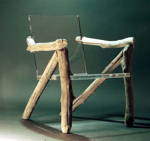Bare Bones Ghost Chair ~ made of six worn pieces of driftwood and suspended thick slabs of translucent acrylic sheet.