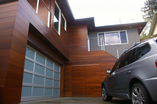 western red cedar siding, steel & glass garage door