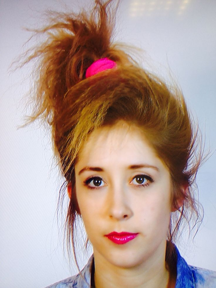 1980s hair do with a pink scrunchie, crimp it and then put it up in a scruffy side pony tail. This is good with layered hair and make sure you hairspray it for a better look and to hold it.