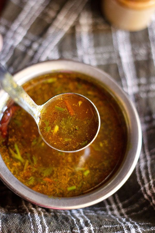 easy rasam recipe made without rasam powder. this rasam is sour, spicy and is warming to the palette. its best to have rasam in chilly winters or when you are suffering from cough and cold. step by step recipe.
