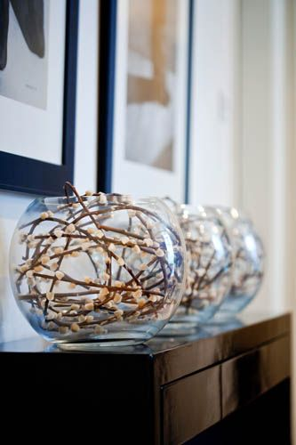 I Love this...pussy willow stems in glass bowl vases...