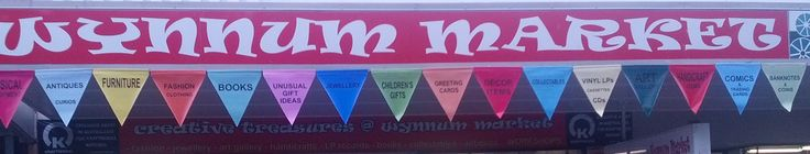 We have new signage out front of store - huge bunting banners fluttering in the wind are quite eye-catching and informative.