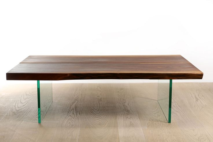 Walnut coffe table with glass legs.