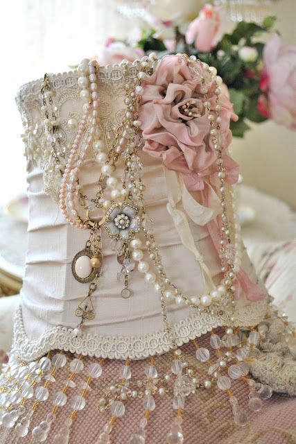 DIY:  Dress up a lampshade by adding beaded trim, ribbon & costume jewelry. Inspiration.
