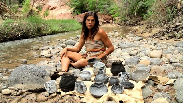 """""""Earth and Fire"""" is a documentary poem about artist and primitive potter Kelly Magleby. Kelly went into the backcountry of Southern Utah with a knife and a buckskin for 10 days to try to learn about Anasazi pottery by doing it the way the Anasazi did it.  Funded by Primitive Found (.org), music by Jason Shaw @ audionautix.com, check out Kelly's art at anasazipottery.net. This the 1st video of 2016 for The Talking Fly short documentary project by filmmaker Steve Olpin, Enjoy!"""