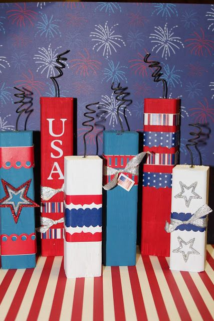 Firecrackers  2×2 scraps of wood.  Cut  7″, 6″ and 4.5″.  Paint them red, white  blue. Use vinyl, stickers, ribbon, sparkly stars to decorate.
