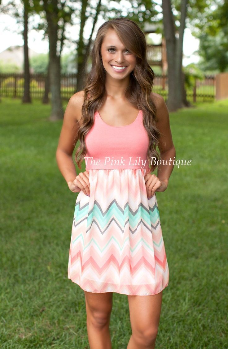 The Pink Lily Boutique - Happy Go Lucky Chevron Dress Coral , $32.00 (http://thepinklilyboutique.com/happy-go-lucky-chevron-dress-coral/)
