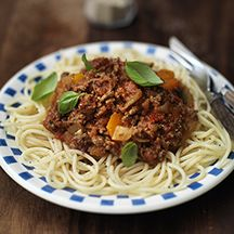Spaghetti Bolognese: use <= 7% fat ground beef, courgette = zucchini, may use canned tomato sauce instead of tomato puree, use whole wheat or brown rice pasta