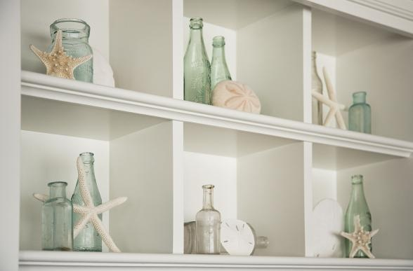 Beach colored bottles and shells would be great in the office shelves...light for summertime.